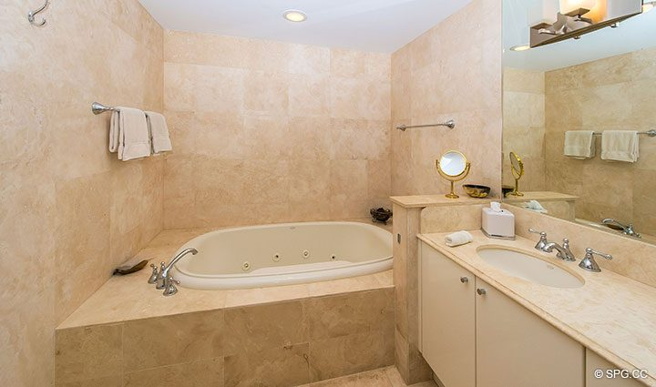 Beautiful Marble Bathroom with Whirlpool Tub in Luxury Oceanfront Condo Residence 5152 Fisher Island Drive, Miami Beach, FL 33109