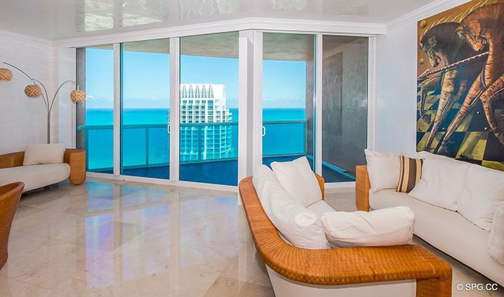 Living Room with Terrace Access in Residence 3806 at Portofino Tower, Luxury Waterfront Condominiums in Miami Beach, Florida 33139
